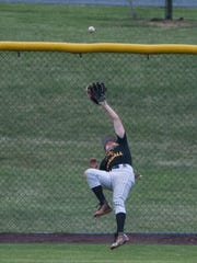 5th Ward's Austin Yerger makes a leaping catch in center field to take away a hit away from Fredericksburg's Michigan Daub on Monday night.