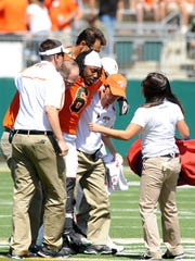 CSU linebacker Myke Sisson is helped off the field after suffering an injury in 2011.