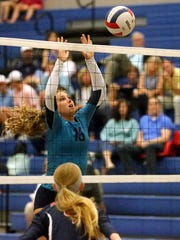 Siegel's Julia Wheeler (13) defends the net against Oakland on Tuesday, Sept. 20, 2016, at Siegel.