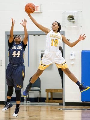 Sanford's Kanisa Tucker (No. 10) intercepts a pass intended for Brooklyn Community's Kamani Bryan (No. 44) in the second half of Sanford School's 72-36 win over Brooklyn Community Arts & Media High School in the Howard MLK Showcase at Howard High School in Wilmington on Monday afternoon.