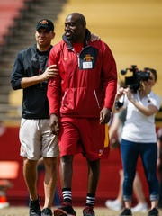 Iowa State head coach Matt Campbell talks with former player Reggie Hayward during their spring game on Saturday, April 8, 2017, in Ames.