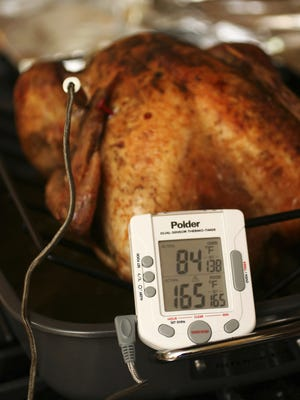 Your turkey is safe to eat when the innermost part of the thigh reaches 165 degrees. If the turkey is stuffed, the stuffing must also reach 165 degrees.