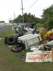 Trash sits on the side of Route 17 in Yona in January 2007.