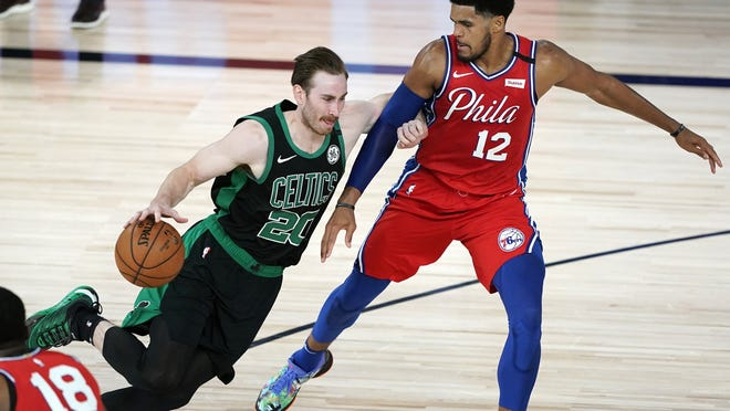 Boston's Gordon Hayward, shown driving past Philadelphia's Tobias Harris in Monday's win, will miss at least four weeks after spraining his ankle late in the game.