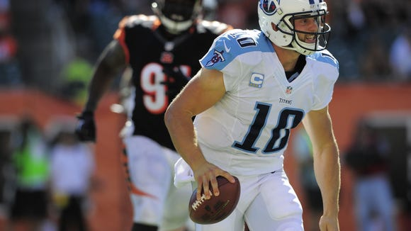 Titans quarterback Jake Locker scrambles against the Bengals last week.
