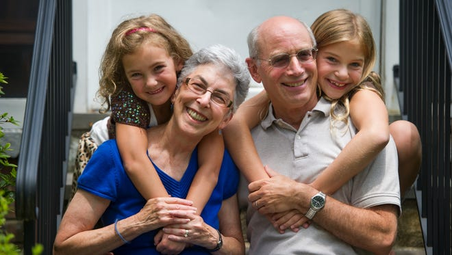 Holly and Howie Stein of Silver Spring, Md., married 44 years, are both working part time as education consultants. They now have more time to enjoy their granddaughters Talia, 8, right, and Elise, 6, visiting from Olney, Md., on July 13, 2014.