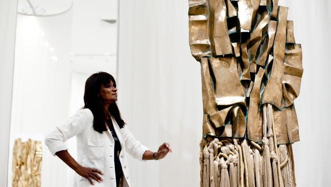 Barbara Chase-Riboud appears with a sculpture, Malcolm X #3, on display at the Philadelphia Museum of Art through Jan. 4.