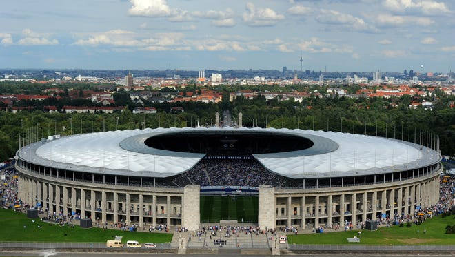 General exterior view of Berlin's Olympic stadium (Olympiastadion) taken as supporters arrive to attend the friendly football match Hertha Berlin vs Real Madrid on July 27, 2011.