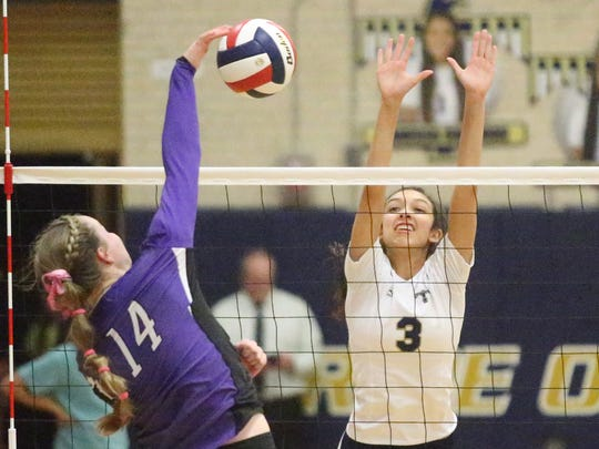 Franklin's Caylee Robalin, 14, goes up for a spike against Coronado's Carolina Mendez, 3, Tuesday night at Coronado.