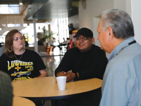 From left, San Juan College School of Energy students Amanda Prugh, Jordan Domingo and their professor, Tony Otero, talk during an interview Sept. 10 at San Juan College's School of Energy in Farmington.