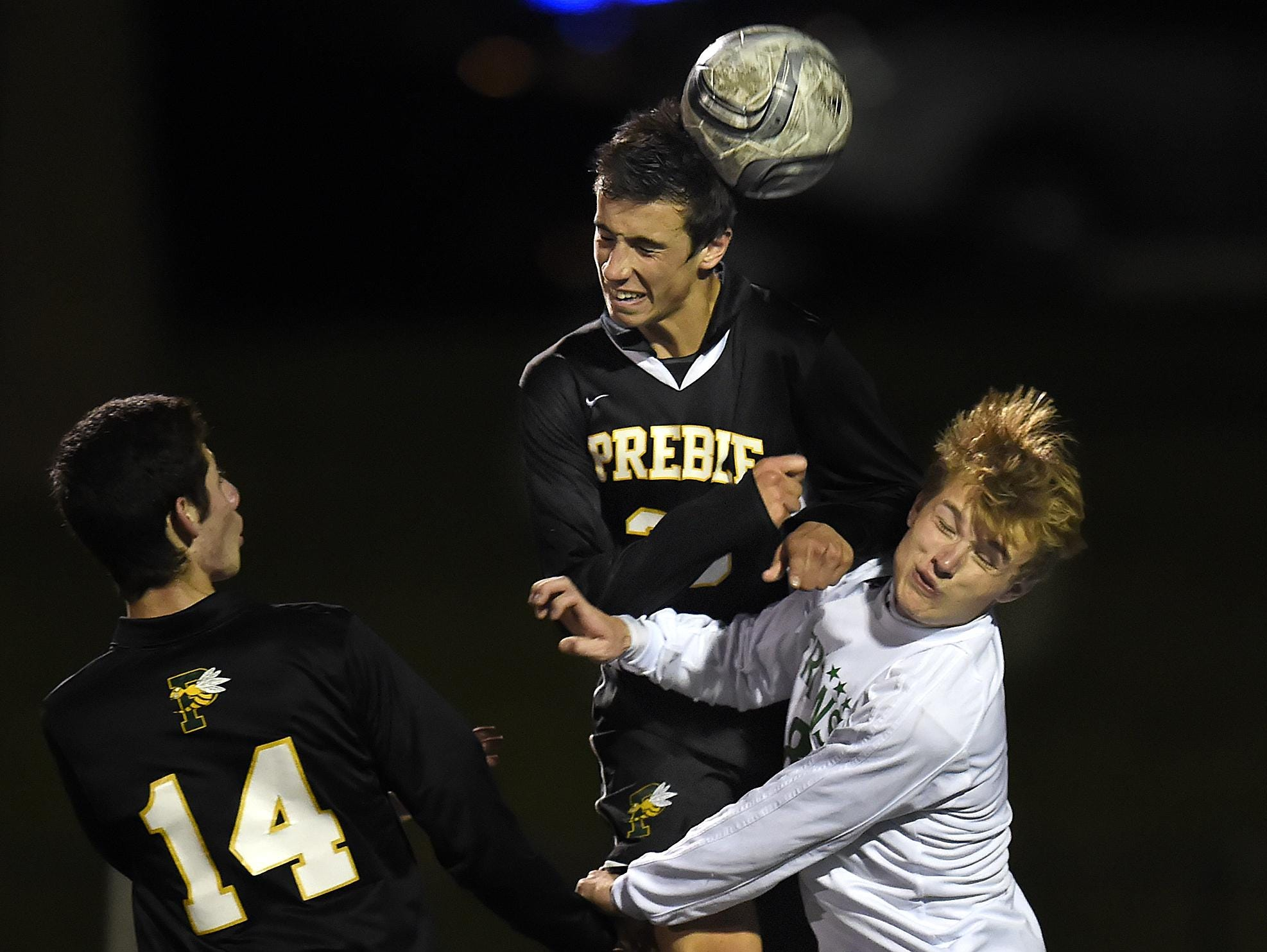 Green Bay Preble's Isaac Putzier, middle, was named the FRCC's offensive player of the year.