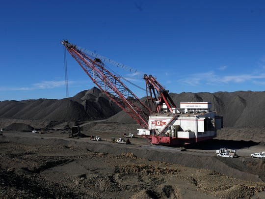 A drag line operates in March at the Dixon Pit at Navajo Mine in Fruitland.