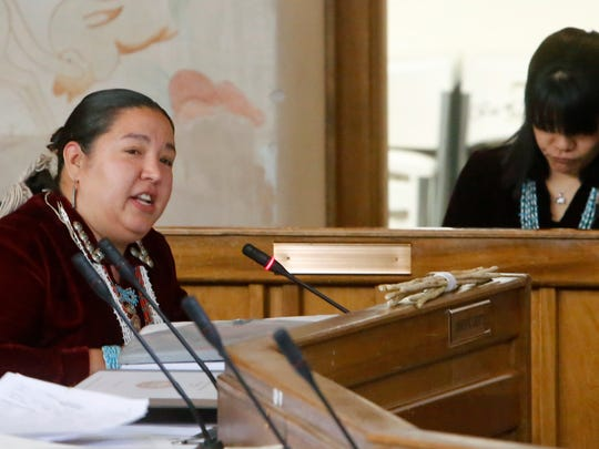 Navajo Nation Council Delegate Amber Kanazbah Crotty, left, talks to U.S. Environmental Protection Agency officials on Tuesday about the effect uranium mining has on chapters she represents in the Northern Agency.