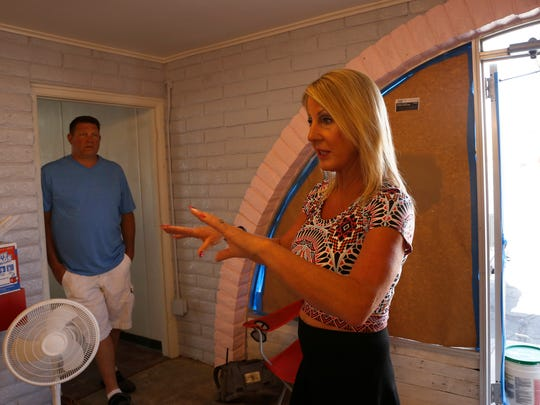 Lori Houston, right, talks on Wednesday about plans for her new store, Simply Fabulicious. She and her husband, Mark Houston, left, plan to open to ice cream parlor and candy store on July 4.