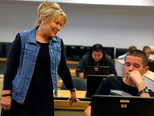 Teacher Patti Shaffer, left, helps a student with his final project on May 28, 2015, during a language arts class at Koogler Middle School in Aztec. Shaffer now teaches at Country Club Elementary School in Farmington. The New Mexico Public Education Department on Friday released the results of teacher evaluations throughout the state. About 78.8 percent of teachers in the Aztec Municipal School were ranked as effective, highly effective or exemplary.