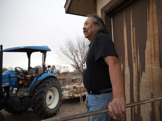 Shiprock farmer Earl Yazzie talks on Friday at his