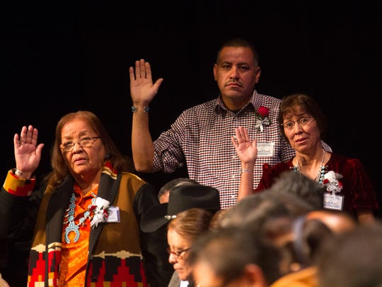 From left, Tooh Haltsooí Council of Naataanii Secretary-Treasurer Sally Ann Joe, President Brian T. Yazzie and Vice President Sadie W. Yazzie  take the oath of office on Friday at the Navajo Nation's Northern Agency inauguration ceremony at the Phil L. Thomas Performing Arts Center in Shiprock.