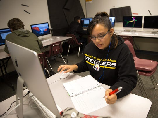 Senior Alexandria Watchman works on her online project Tuesday during class at Rocinante High School in Farmington.