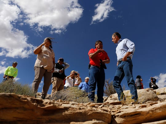 Sen. Martin Heinrich, D-N.M., talks on Oct. 2, 2015, with Gilbert Dayzie, a civil engineer with the Shiprock Abandoned Mine Land Reclamation Program, while touring a former uranium mine in the Red Valley Chapter in Arizona.