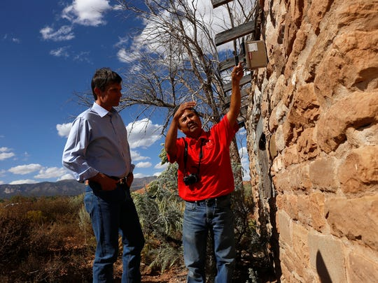 At right, Melvin H. Yazzie, senior reclamation specialist with the Navajo Abandoned Mine Land Reclamation Program, speaks on Oct. 2, 2015, with Sen. Martin Heinrich, D-N.M., as he uses a Geiger counter at a former uranium mine in the Red Valley Chapter in Arizona.