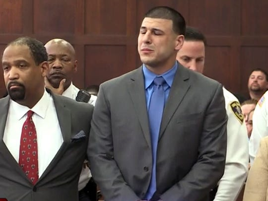 In this still image from video, Aaron Hernandez, right,