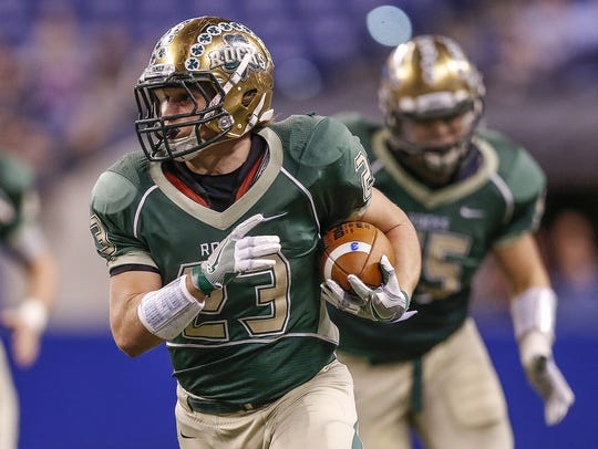 Nate Froelich (23) and Westfield takes the step up