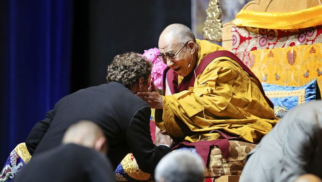 Michael Fitzpatrick got a blessing from His Holiness the 14th Dalai Lama at the KFC Yum! Center.  May 20, 2013