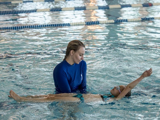 Instructor Savannah O'Neil, 19, helps Alana Burke, 6, of Port Huron, do a back stroke during a beginning swim class Thursday, June 23, 2016 at the YMCA of the Blue Water Area.