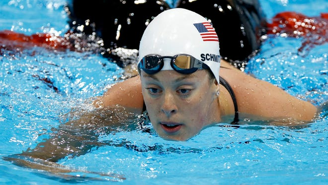 Allison Schmitt reacts after competing in a women's 200-meter freestyle swimming heat during the 2012 Summer Olympics in London.