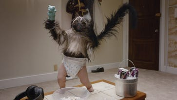 """This image provided by Mountain Dew shows a """"Puppymonkeybaby"""" in a scene from its Super Bowl  ad"""