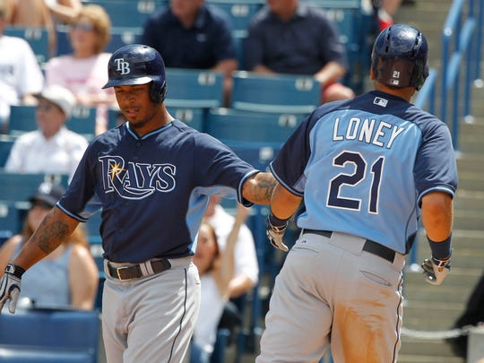 Apr 1, 2015; Tampa, FL, USA; Tampa Bay Rays first baseman James Loney (21) celebrates with left fielder Desmond Jennings (8) at home plate as they both scored during the sixth inning against the New York Yankees at George M. Steinbrenner Field. Mandatory Credit: Kim Klement-USA TODAY Sports