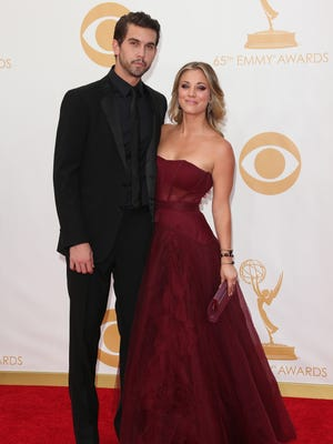 Ryan Sweeting and Kaley Cuoco arrive at the 65th Annual Primetime Emmy Awards at Nokia Theatre L.A. Live on Sept. 22, 2013 in Los Angeles. The couple announced their engagement on Sept. 26, 2013.