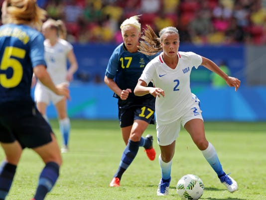 FILE - In this Aug. 12, 2016, file photo, United States' Mallory Pugh (2)  controls the ball past Sweden's Caroline Seger during a quarterfinals match in the women's Olympic football tournament in Brasilia, Brazil. Pugh, who decided to leave UCLA earlier this year to pursue a professional career, has been acquired by the Washington Spirit of the National Women's Soccer League.  (AP Photo/Eraldo Peres, File)