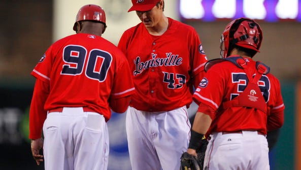 Louisville Bats pitcher Homer Bailey (43) hands the