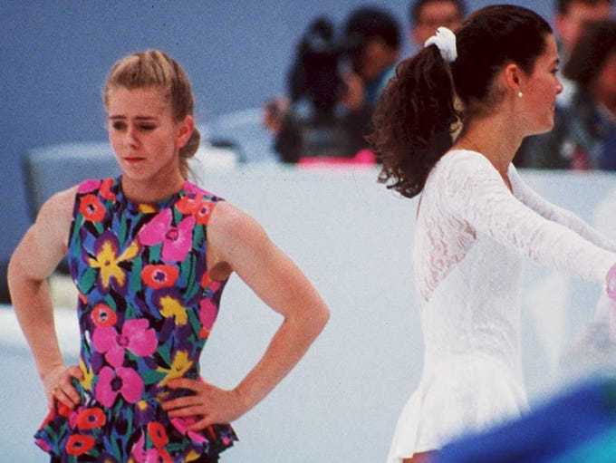 US figure skaters Tonya Harding (L) and Nancy Kerrigan avoid each other during a training session in Hamar, Norway, during the Winter Olympics. Kerrigan was hit on the knee in January 1994 during the US Olympic Trials. Later, authorities discovered that Harding's ex-husband and bodyguard masterminded the attack in hopes of improving Harding's chances at the US Trials and the Olympics.