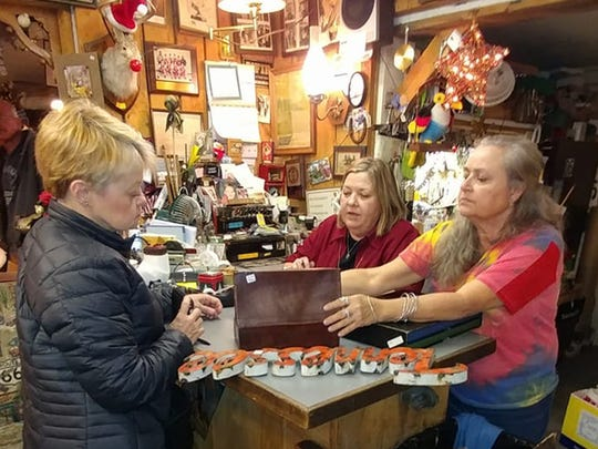 Customers uncover hidden treasures at Buried Treasures Antiques, Furniture & Gifts in Fairview.
