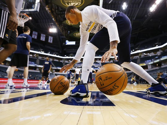 Indiana Pacers guard Joe Young works on his ball-handling skills before a recent game against the Detroit Pistons at Bankers Life Fieldhouse.
