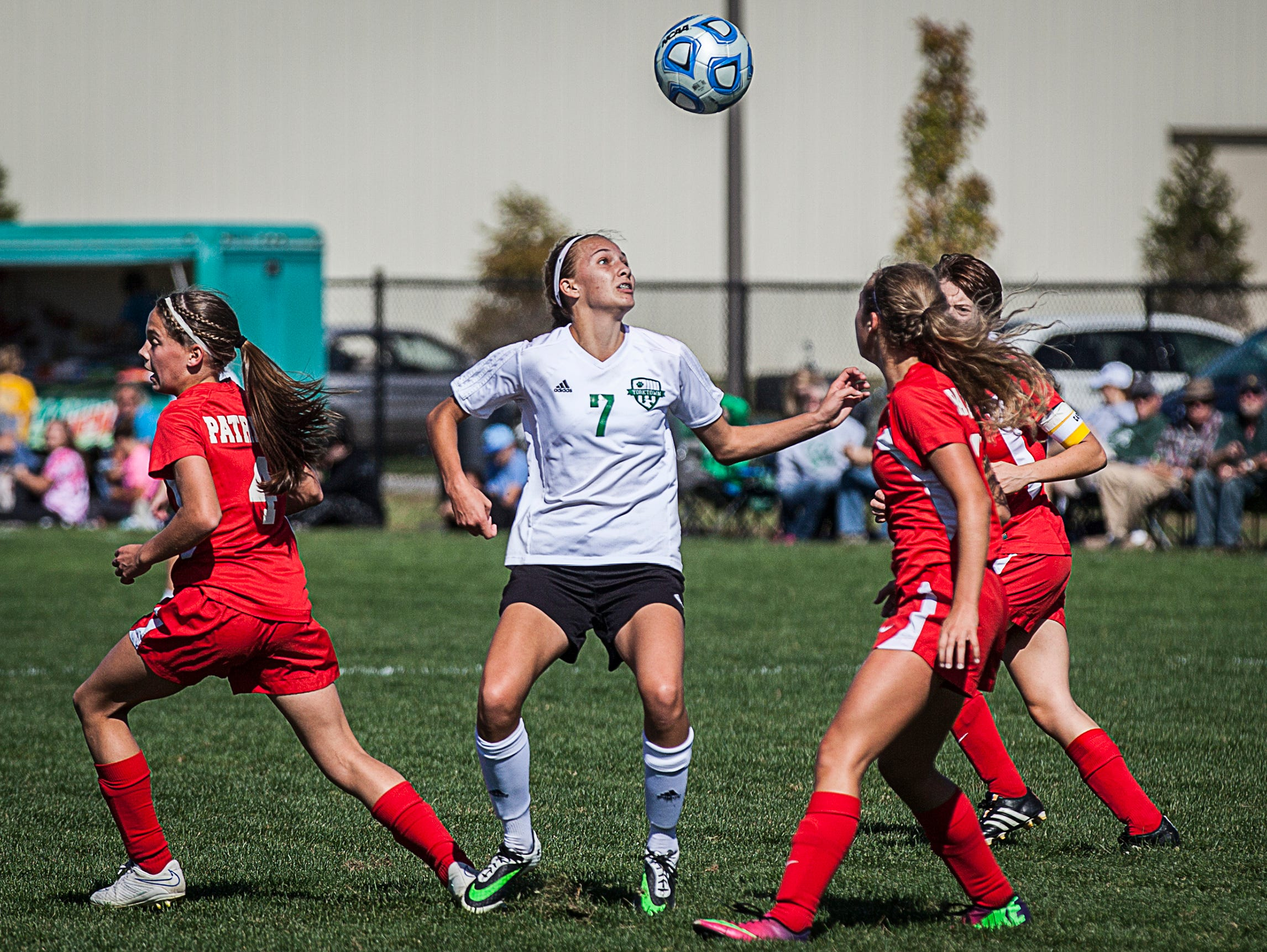 Yorktown's Hannah Rapp fights for possession against Jay County's defense during their game at the Yorktown Sports Park on Saturday, Oct. 10, 2015.