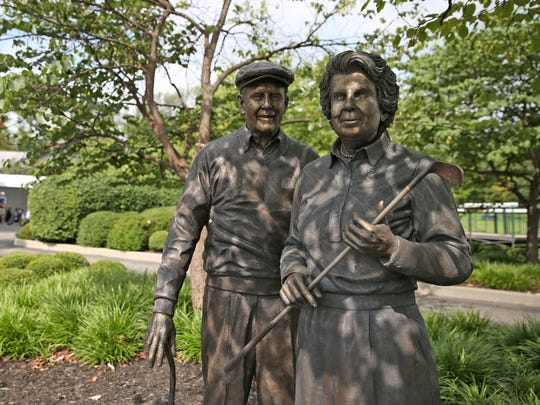 This statue of Pete and Alice Dye stands at Crooked Creek Golf Club in Carmel, Friday, August 19, 2016.  The golf course was designed by Pete Dye.