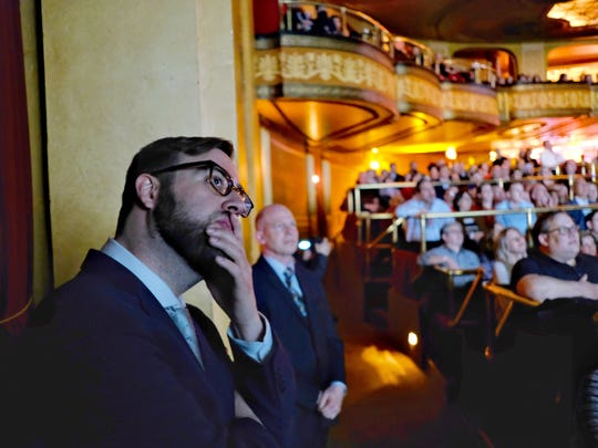 """Director Joshua Riehl watches the world premiere of his film """"The Russian Five"""" during the opening night for the Freep Film Festival at The Fillmore in downtown Detroit on Wednesday, April 11, 2018."""