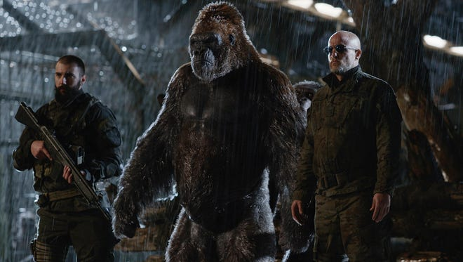"Woody Harrelson (right) leads the fight against Caesar and the apes in ""War for the Planet of the Apes."""