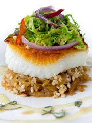 Sea bass on barley with caramelized onion and maple-sage