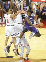 ACU's B.J. Maxwell, right, drives around the Texas Tech defense. The No. 21 Red Raiders beat ACU 74-47 in the nonconference men's basketball game a year ago in Lubbock.