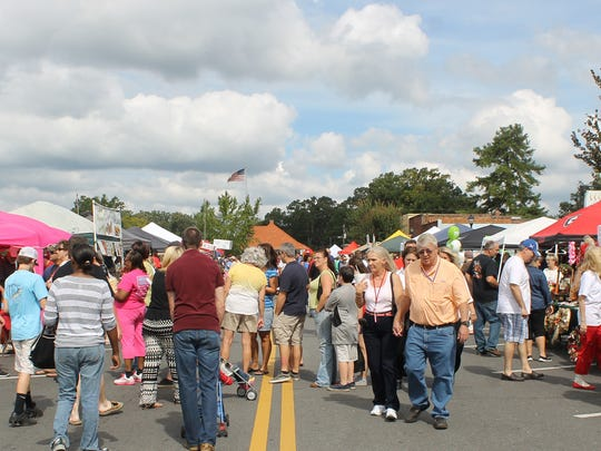Festival-goers explore Main Street in Lavonia.