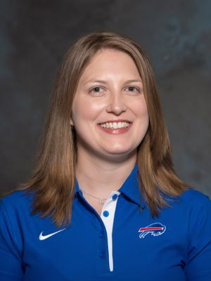 A May 2015 photo shows Kathryn Smith of the Buffalo Bills NFL football team. The Bills promoted Smith to be their special teams quality control coach, making her the first full-time female member of an NFL coaching staff. The team announced the move in a release Wednesday night, Jan. 20, 2016. Smith was an administrative assistant this season for Bills assistant coaches under Rex Ryan, with whom she has worked for seven years.