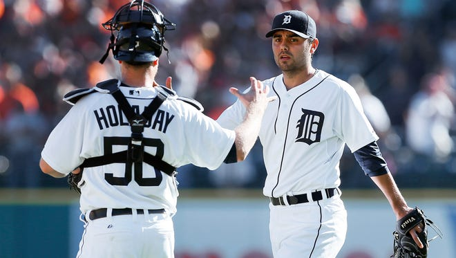 Detroit Tigers relief pitcher Joakim Soria celebrates beating the Chicago White Sox on Wednesday, Sept. 24, 2014.