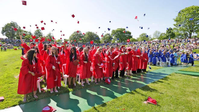 Graduates fling their mortar boards at  conclusion of The Sheboygan Area School District Commencement at Vollrath Bowl Sunday June 4, 2017 in Sheboygan, Wis.