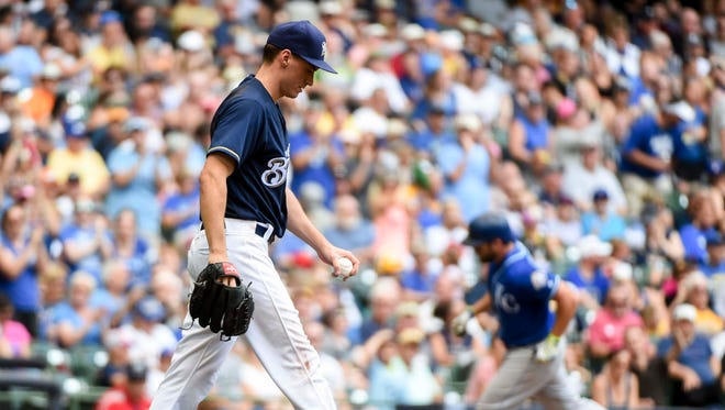 Jun 27, 2018; Milwaukee, WI, USA; Milwaukee Brewers pitcher Brent Suter (35) reacts after giving up a solo home run to Kansas City Royals third baseman Mike Moustakas (8) in the seventh inning at Miller Park. Mandatory Credit: Benny Sieu-USA TODAY Sports