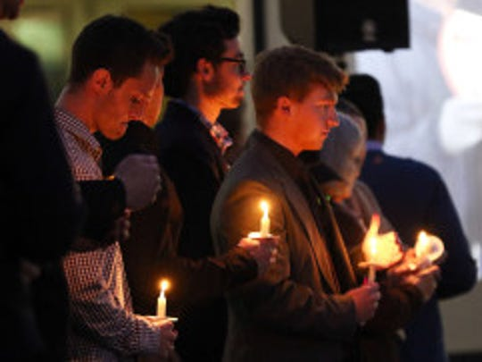 Close friends of UW-Stout student Hussain Saeed Alnahdi spoke during a memorial service for him on campus Thursday, and later lit candles for a moment of silence.