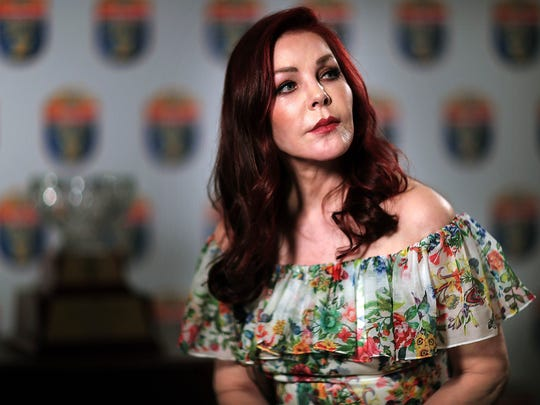 Priscilla Presley talks to the media Sunday evening before a ceremony at the Hilton Memphis Hotel where she received the 2018 Distinguished Citizen Award from the AutoZone Liberty Bowl. Presley talked during the interview about Elvis' love for football and reminisced about how he and friends would watch games at Graceland, each TV tuned to a different channel.